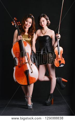 Full body two woman in musical art concept-black background