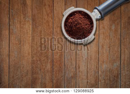 Coffee grind in group on wooden background, stock photo