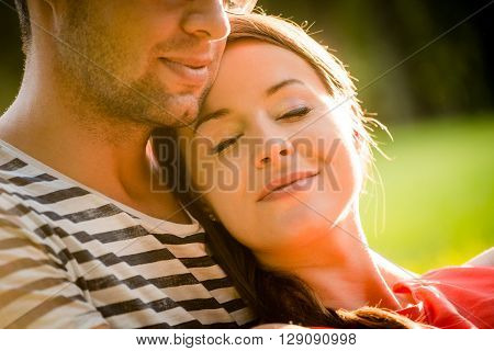 Intimate moments - young couple embracing and hugging in nature