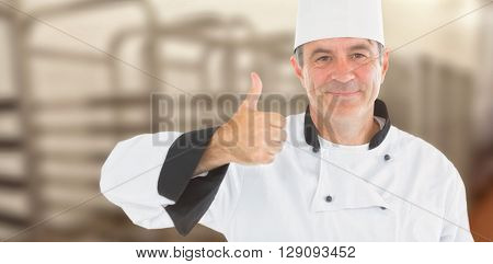 Composite image of friendly chef smiling with thumbs up against a blurred background