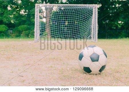 Football and soccer goal . vintage tone .