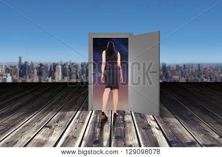 Asian businesswoman walking against wooden planks