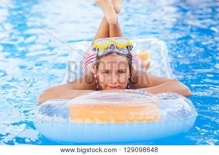 Cute girl relaxing in pool