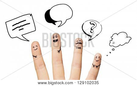 communication, family, people and body parts concept - close up of four fingers with smiley faces over text clouds