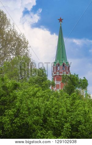 Moscow, Russia - May, 6, 2016: view of a Moscow Kremlin tower under the trees
