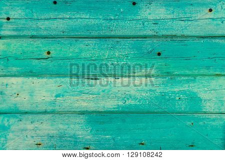 Texture Of Wooden Planks With Peeling Turquoise Blue Color Paint. Detailed Background Photo Texture.