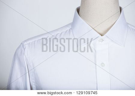 Tailored white shirt on a mannequin in studio