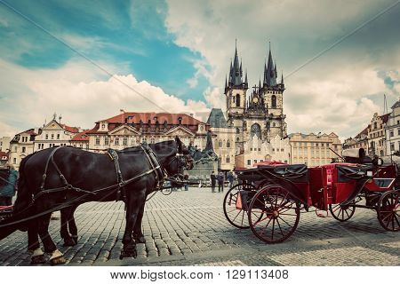 Old Town of Prague, Czech Republic. Horse carriage for tourists on the square with view on Tyn Church. Vintage