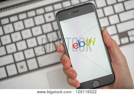 Melbourne, Australia - May 10, 2016: Using eBay app on iphone for online shopping. eBay is an online auction and shopping website.
