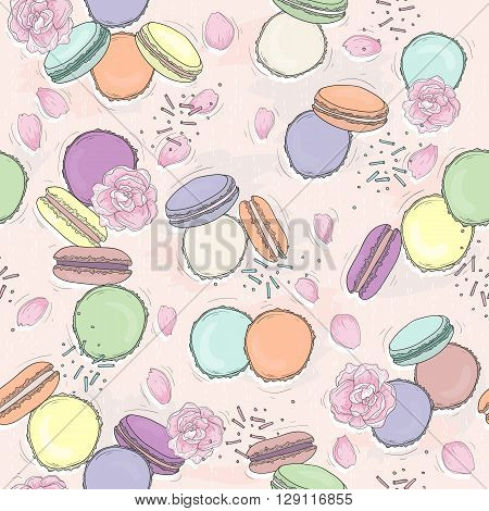Seamless floral pattern with macaroons. Vector background with sweets and flowers.