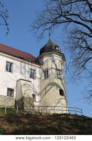 part of white chateau in Frydek-Mistek with a tower