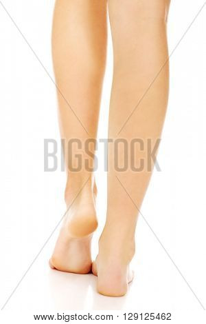 The legs of a young woman