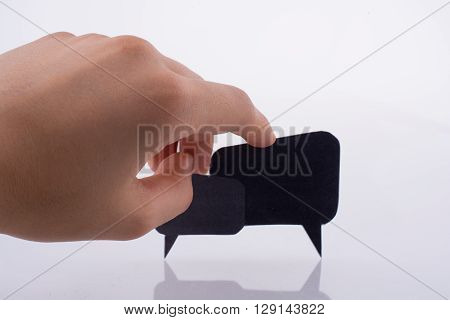 Hand holding dialogue boxes on a white background