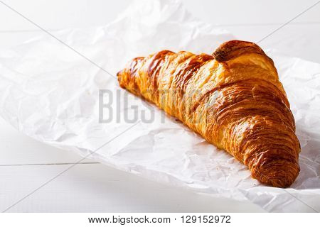 French pastry Croissant on white baking paper.