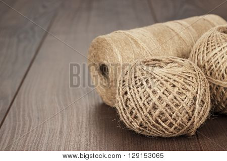 reels and balls of durable thread on the wooden table