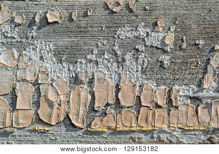 Old grunge wooden board with cracked paint