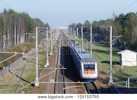 SOLNECHNOE, LENINGRAD OBLAST, RUSSIA - MAY 1, 2016: High speed train Allegro built by French Alstom go from Helsinki to St. Petersburg. With maximum speed 220 km/h, the journey takes 3.5 hours