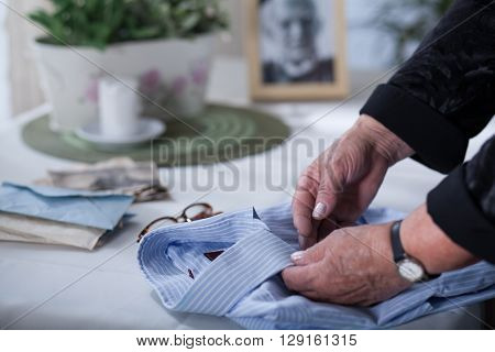 Old Woman's Hands On Men's Shirt