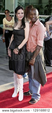 """Mary Louise Parker and Romany Malco at the Los Angeles premiere of """"The 40 Year Old Virgin"""" held at the ArcLight Theatre in Hollywood, USA August 11, 2005."""
