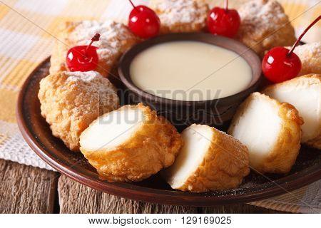 Dessert Leche Frita With Condensed Milk And Cherries Closeup. Horizontal