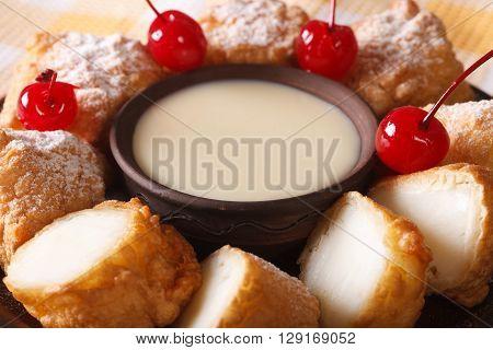 Fried Milk With Condensed Milk And Cherries Macro. Horizontal