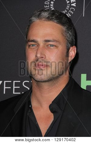 LOS ANGELES - MAR 19:  Taylor Kinney at the PaleyFest 2016 - Dick Wolf Salute at the Dolby Theater on March 19, 2016 in Los Angeles, CA