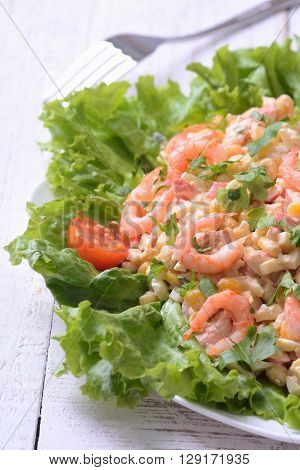 Seafood salad with shrimps on wooden backgraund