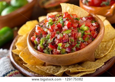 A delicious home made salsa pico de gallo with tomato red onion lime cilantro and jalapeno pepper.
