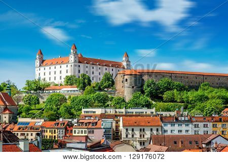 View on Bratislava castle on the green hill with old houses at the bottom from the Michael's watch tower in Slovakia