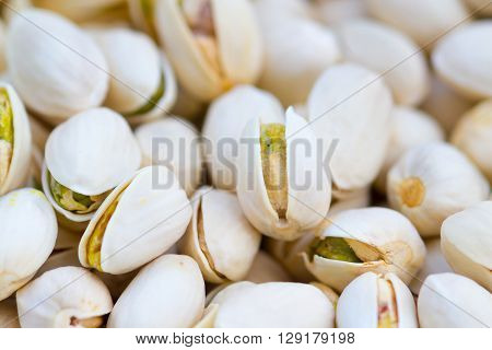 pistachio nuts :The pistachio a member of the cashew family is a small tree originating from Central Asia and the Middle East. The tree produces seeds that are widely consumed as food