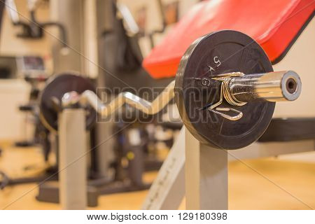 Barbell for weight training to build muscle at fitness room