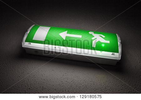 Green Illuminated Emergency Exit Sign In Dark