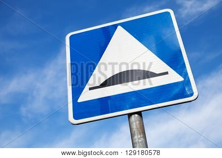 Speed Bump. Square Road Sign Over Cloudy Sky