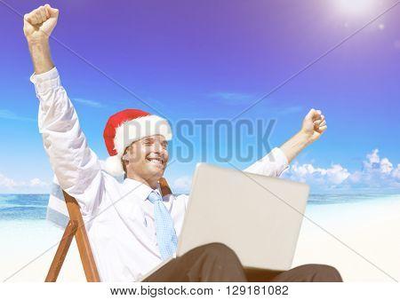 Businessman working on the beach on Christmas.