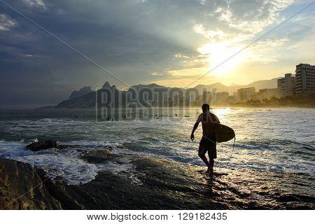 Surf at sunset in Arpoador beach at Ipanema in Rio de Janeiro