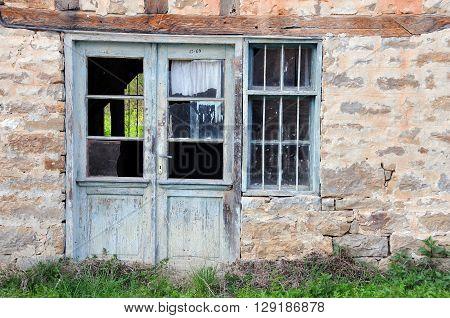 VETRINTSI VILLAGE, BULGARIA - MARCH 28, 2016; Abandoned building in the springtime