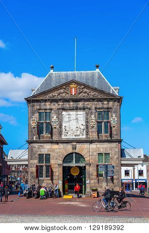 Gouda Netherlands - April 20 2016: The Waag with unidentified people. It was built in 1667 and was used for weighing goods especially cheese to levy taxes. It now is a national monument