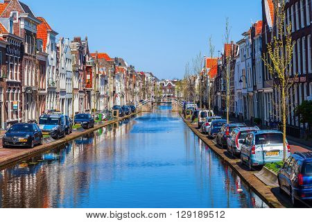 Gouda Netherlands - April 20 2016: canal in Gouda. Gouda is world famous for its cheese that becomes trade here.
