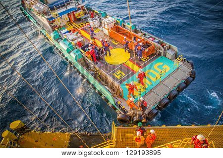 crew boat receive and transfer passenger to oil and gas processing platform at boat landing
