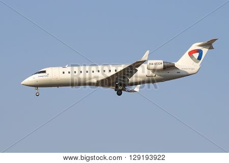 SAINT PETERSBURG, RUSSIA - MARCH 28, 2016: Aircraft Bombardier CRJ-200LR ( RA-67239) aviation enterprise