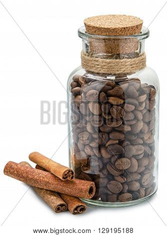 Coffee jar and cinnamon on white background