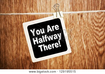 You are Halfway There. Text written on a chalkboard
