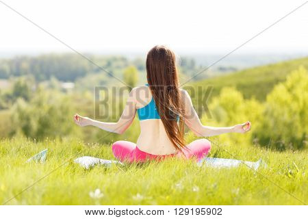 Young Woman Practicing Yoga Poses At Outdoor