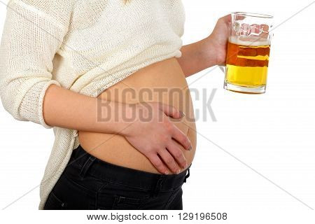 Young woman drinking beer on white background