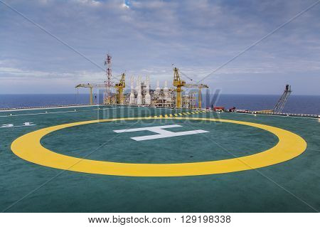 Oil and gas processing platform at helicopter pad
