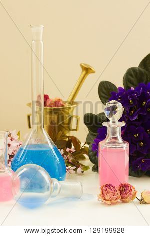 Dry flowers and vials  of tincture or oil, aromatherapy and herbal medicine  concept poster