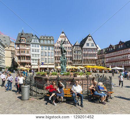 People Visit Romerberg (romerplatz) With Old Buildings  In Frankfurt