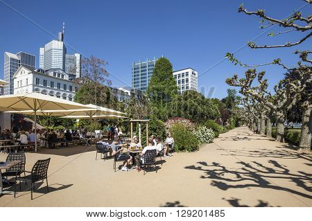 People Relax At The Bank Of River Main In Nizza Gardens