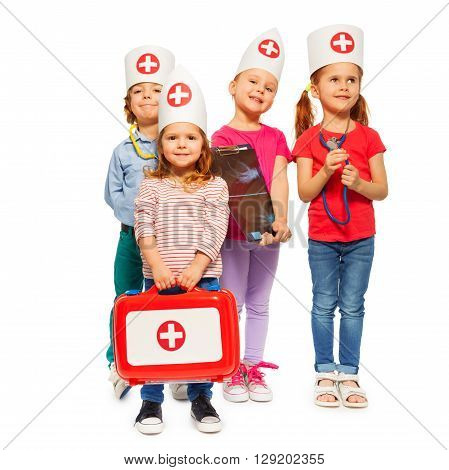 Portrait of four little doctors with red toy  first aid box, isolated on white