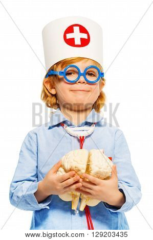Young boy with medical cap and toy glasses, holding cerebrum dummy, isolated on white